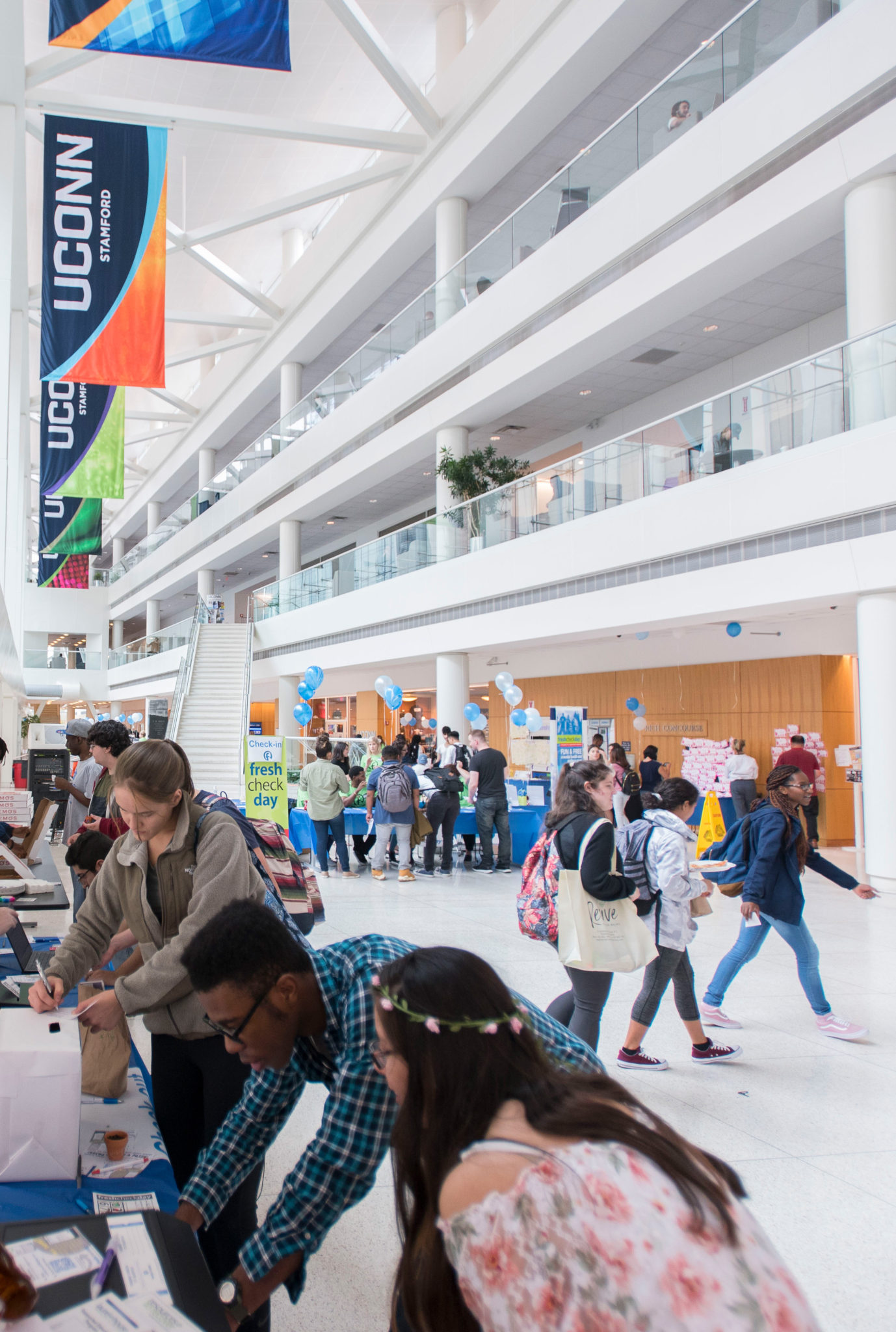 Students participate in Fresh Check Day in the concourse (atrium) at Uconn Stamford