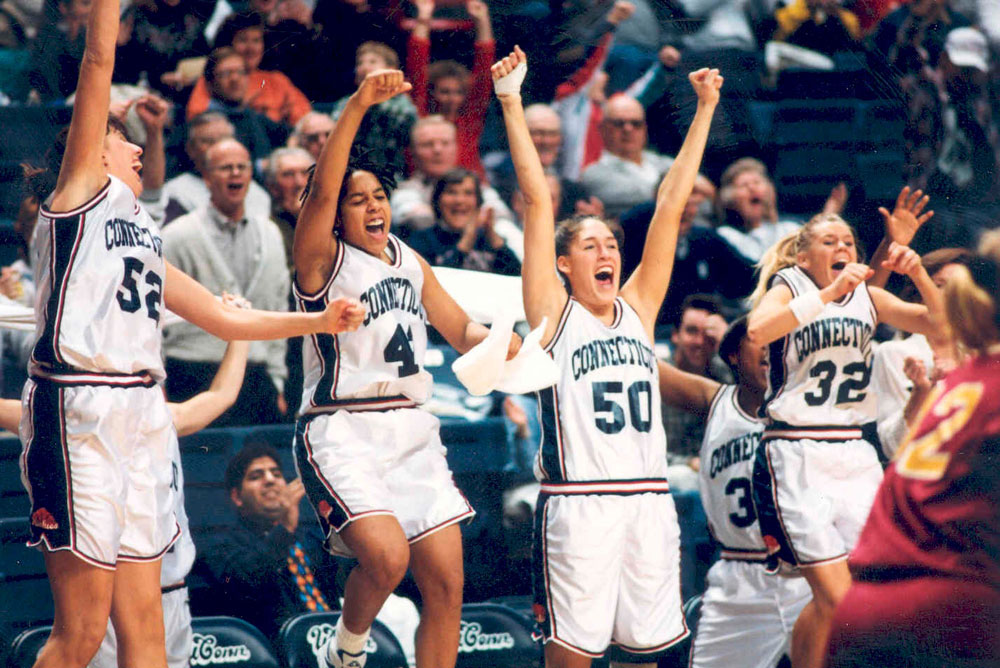 1995 UConn Women's basketball team cheers from the bench