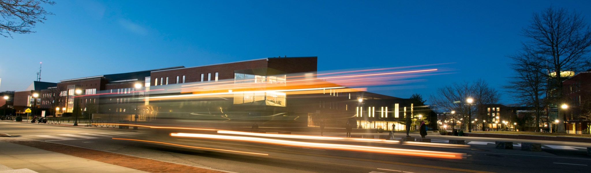 Night views of the Student Union with light trails from cars traveling on Hillside Road