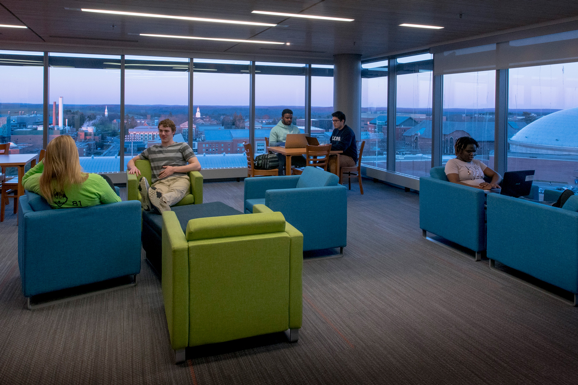 Students studying and hanging out in a study lounge of the Next Generation Connecticut Hall
